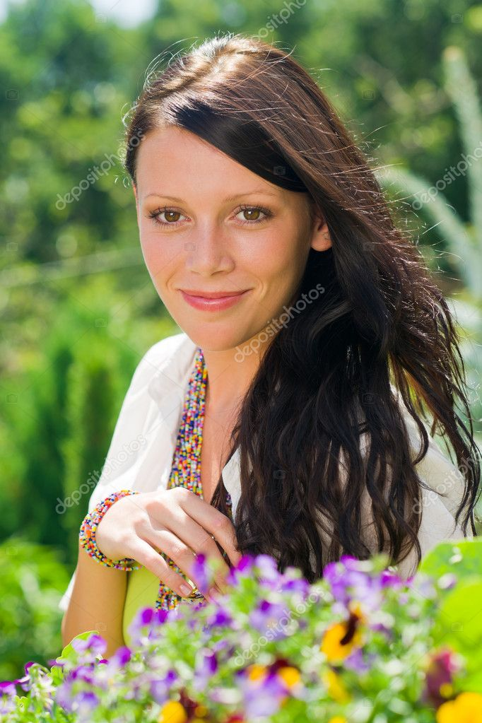 Summer garden beautiful young woman smiling flowers — Stock Photo #6441127