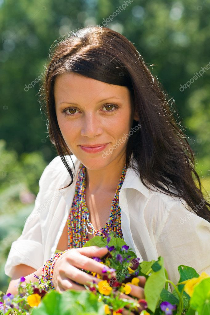 Summer garden beautiful young woman smiling flowers  Stock Photo #6441133