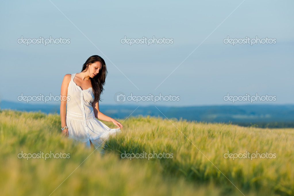 Summer sunset beautiful brunette woman walk in wheat corn field — Stock Photo #6441329