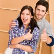 Home improvement young happy couple thumb up — Stock Photo