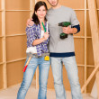 Home improvement young couple with repair tools - Stock Photo