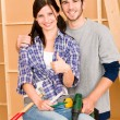Home improvement young couple DIY repair tools - Stock Photo