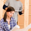 Home improvement young couple with blueprints - Stock Photo