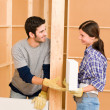 Stock Photo: Home improvement young couple building brick wall