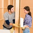 Home improvement young couple building brick wall — Stock Photo