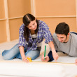 Home improvement young couple work on renovations — Stock Photo