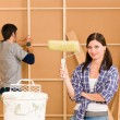 Home improvement: young couple fixing new house — Stock Photo #6696184