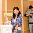 Home improvement: young couple fixing new house — Stock Photo #6696191