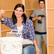 Home improvement: young couple fixing new house - Stock Photo