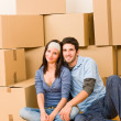 Moving new home young couple sitting floor — Stock Photo #6696217