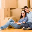 Moving new home young couple sitting floor — Stock Photo