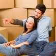 Moving new home young couple sitting floor — Stock Photo #6696224