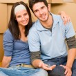 Moving new home young couple hold keys — Stock Photo