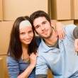 Moving new home young couple hold keys — Stock Photo #6696229