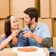 Moving new home young couple have lunch — Stock Photo #6696232