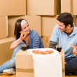 Moving new home young couple eat pizza — Stock Photo #6696237