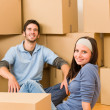 Moving new home young couple sitting floor — Stock Photo #6696244