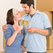 Moving into new home young couple toast — Stock Photo