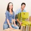 Moving new home young couple carry chairs — Stock Photo #6696249