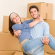 Moving new home young man holding woman — Stock Photo #6696252