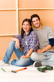 Home improvement young couple relax on floor — Stock Photo