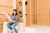 Home improvement young couple with blueprints — Stock Photo