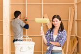 Home improvement: young couple fixing new house — Stock Photo