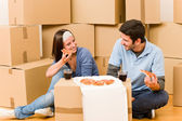 Moving new home young couple eat pizza — Stock Photo