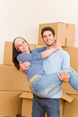 Moving new home young man holding woman — Stock Photo