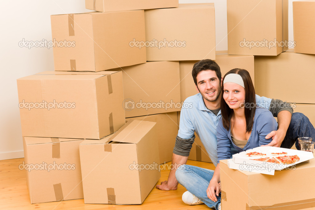 Moving into new home young happy couple eating pizza  Stock Photo #6696239