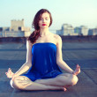 Young attractive woman doing meditation and yoga — Stock Photo