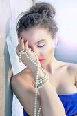 Luxury girl and pearls — Stock Photo