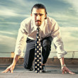 Portrait of a businessman on the starting blocks — Foto Stock