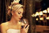 Beautiful woman drinking red wine — Stock Photo