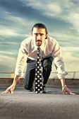Portrait of a businessman on the starting blocks — Stock Photo