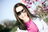 Portrait of beautiful young woman in fashion sunglasses — Stock Photo