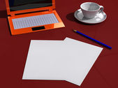 Desk with papers, laptop, pencil and cup — Stock Photo