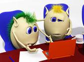 Twee marionetten laptop kijken met lede ogen — Stockfoto
