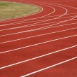 Asphalt for runners track turn zoomed foto — Stock Photo #5938565
