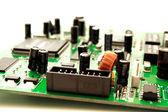 Foto of green computer circuit board transistors — Stock Photo