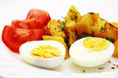 Zoomed foto of tomatoes, potatoes and eggs — Stock Photo