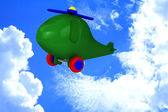 Green helicopter with tires fly in sky — Stock Photo