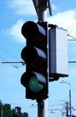 Foto of traffick lights showing green signal — Stock Photo