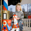 Stock Photo: Carousel merry go round child horse