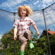 Child jumping trampoline — Stock Photo #5464569