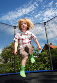 Child jumping trampoline — Stock Photo