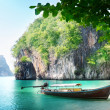 Long boat on island in Thailand - Stock Photo