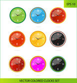 Cretive colored clocks on the white — Stock Vector