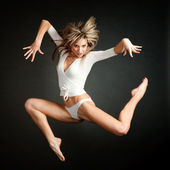 Attractive jumping woman dancer — Stock Photo