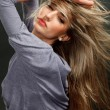 Portrait of a beautiful girl with flying blond hair — Stock Photo #6418821